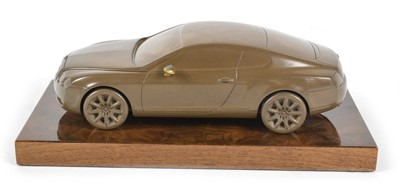 Lot 40 - bronzed resin desk ornament of a Bentley Continental GT on a lustrous wooden base