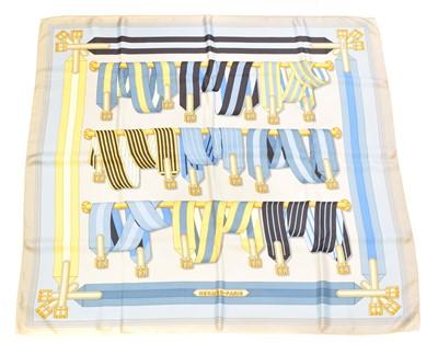 """Lot 91 - A Hermès """"Les Sangles"""" silk scarf by J. Metz"""