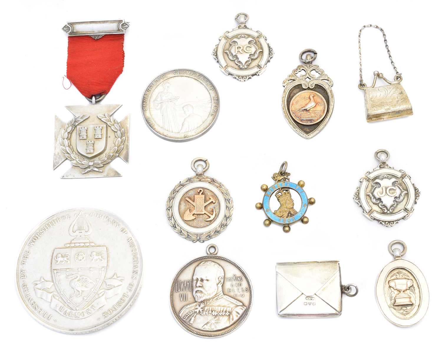 Lot 45 - A selection of silver medallions and fobs
