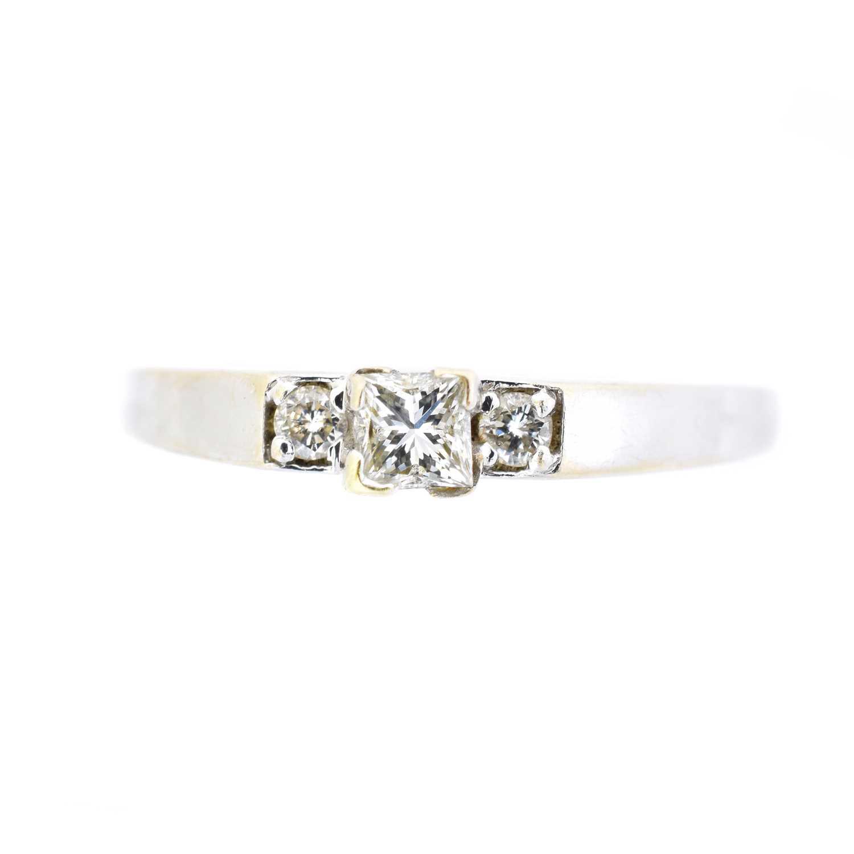 Lot 18 - A diamond three stone ring