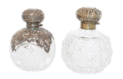 Lot 102 - Two silver mounted clear glass scent bottles