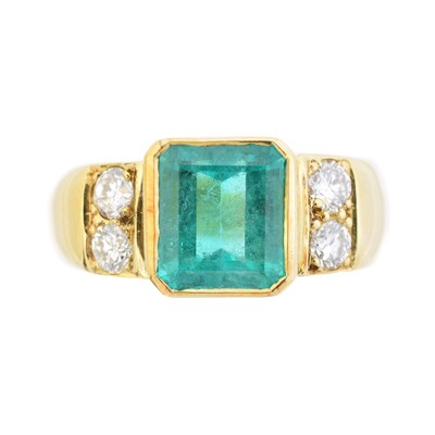 Lot An 18ct gold emerald and diamond dress ring