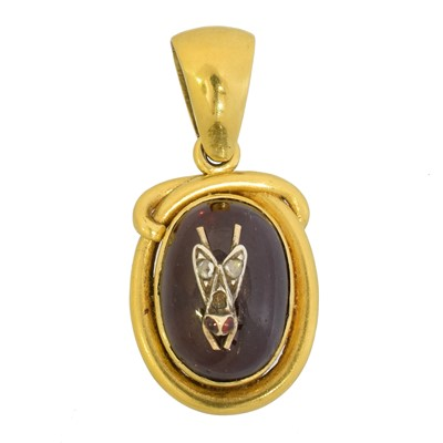 Lot 52 - A Victorian foil back garnet and diamond bug pendant