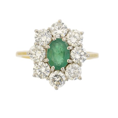 Lot 102 - An 18ct gold emerald and diamond cluster ring