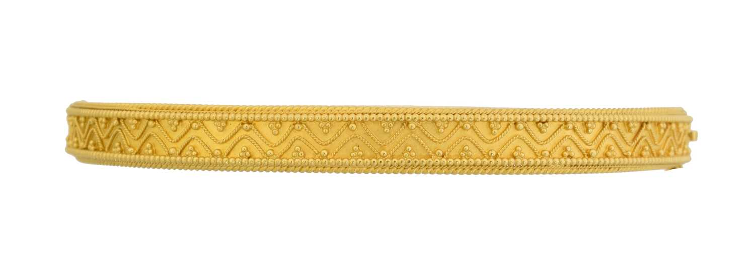 Lot 24 - A Victorian Etruscan Revival hinged bangle