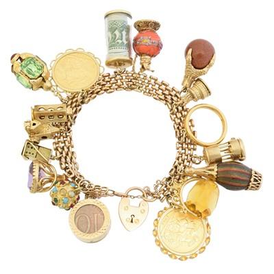 Lot 26 - A charm bracelet