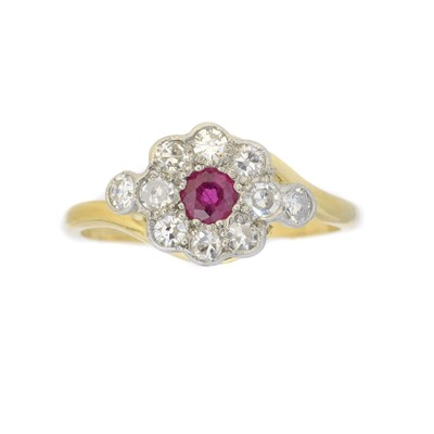Lot 80 - A ruby and diamond cluster ring
