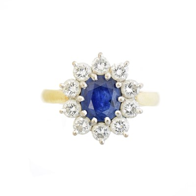Lot 111 - An 18ct gold sapphire and diamond cluster ring