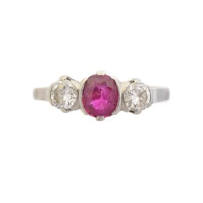 Lot 76 - A ruby and diamond three stone ring