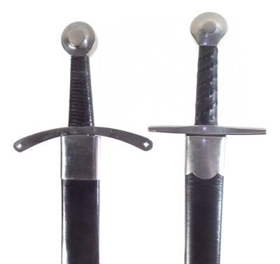 Lot 29 - Two modern replica swords and scabbards