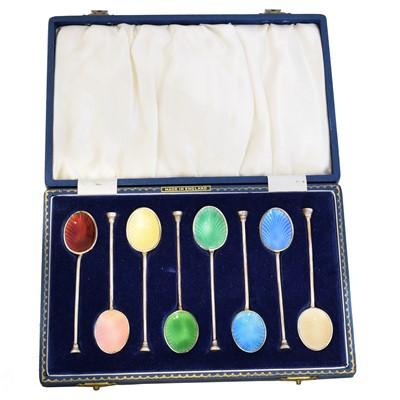 Lot 206 - An Elizabeth II cased set of enamel coffee spoons