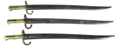 Lot 42 - Three Chassepot M1866 bayonets and scabbards