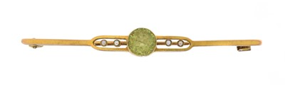 Lot 9 - An early 20th century peridot and seed pearl brooch