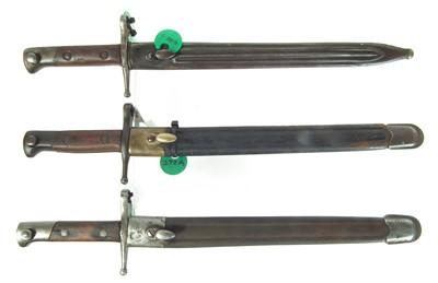 Lot 36 - Three Italian bayonets and scabbards