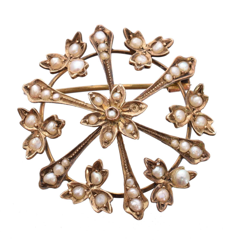 Lot 2 - An early 20th century split pearl brooch
