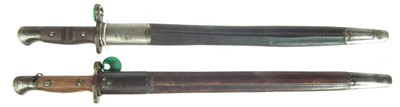 Lot 53 - Two British / American bayonets and scabbards