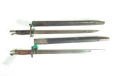 Lot 56 - Two British / American bayonets and scabbards