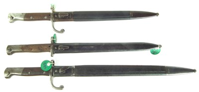 Lot 81 - Three bayonets and scabbards