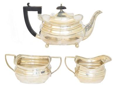 Lot 184 - A silver three piece teaset