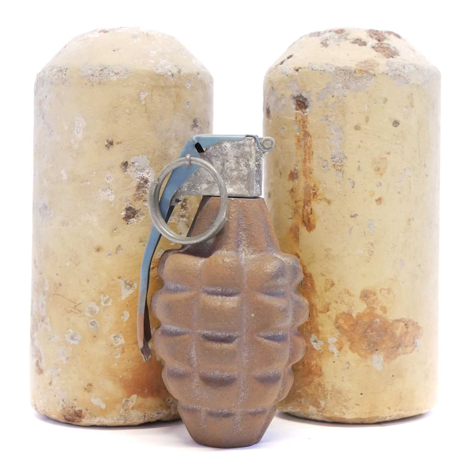 Lot 114 - WWII USA pineapple grenade and two German concrete mines or grenades
