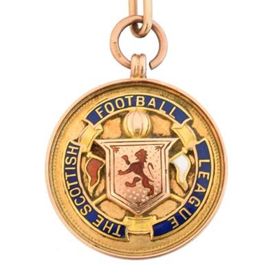 Lot 58 - An early 20th century 9ct gold enamel football medallion