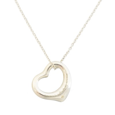 Lot 64 - A silver open heart pendant by Elsa Peretti for Tiffany & Co.
