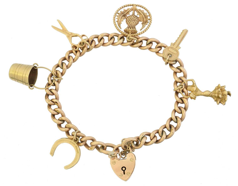 Lot 19 - A 9ct gold charm bracelet