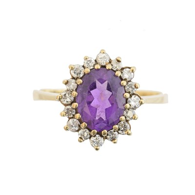 Lot 56 - A 9ct gold amethyst and diamond cluster ring