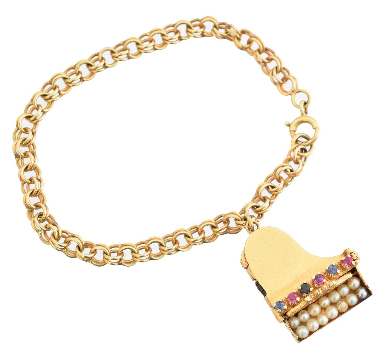 Lot 30 - A mid 20th century charm bracelet