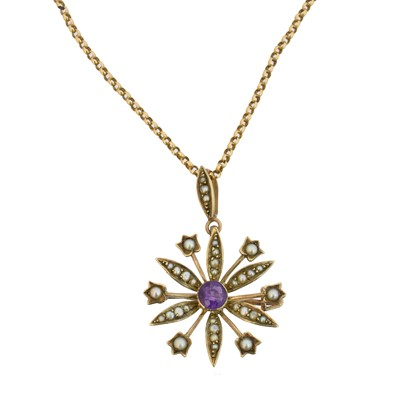 Lot 74 - An early 20th century amethyst and split pearl pendant