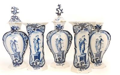 Lot 235 - Garniture of five Delft vases