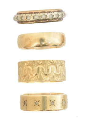 Lot 66 - Four 9ct gold band rings