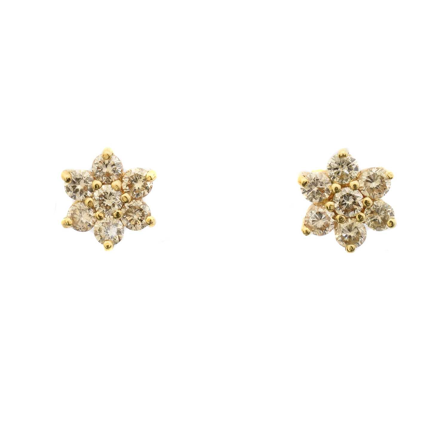 Lot 42 - A pair of 18ct gold brilliant cut diamond floral cluster earrings