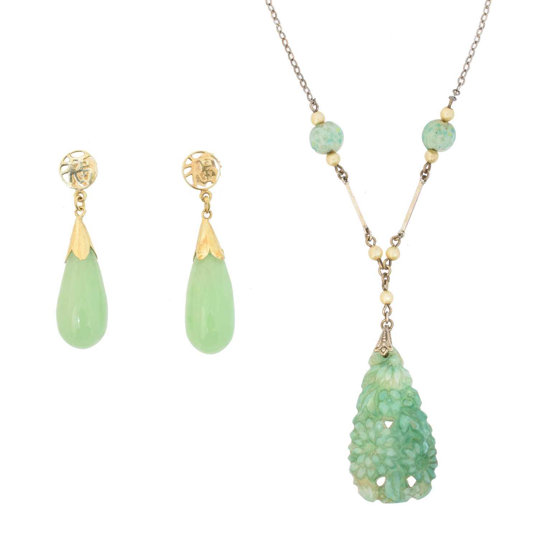 Lot 24 - A pair of jade earrings