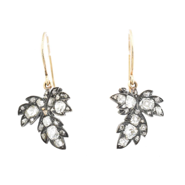 Lot 47 - A pair of diamond earrings