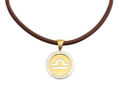 Lot 71 - An 18ct gold and stainless steel Zodiac Tondo necklace by Bulgari