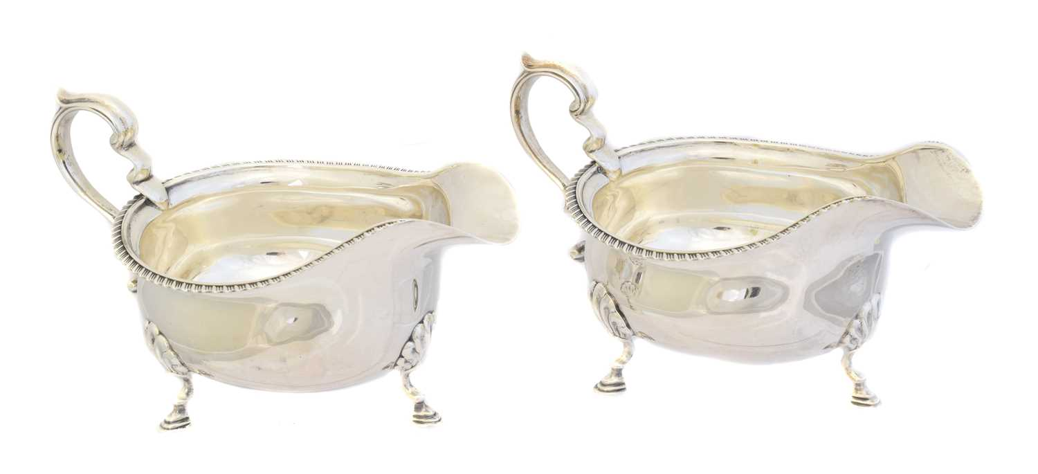 Lot 129 - A pair of George V silver sauce boats
