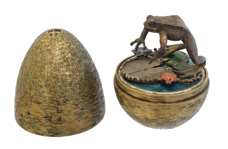 Lot A silver gilt and enamel surprise egg by Stuart Devlin