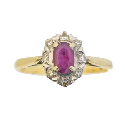 Lot 59 - An 18ct gold ruby and diamond cluster ring