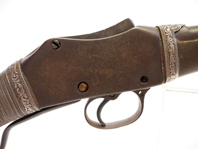 Lot Martini Henry carbine with white metal decorative binding.