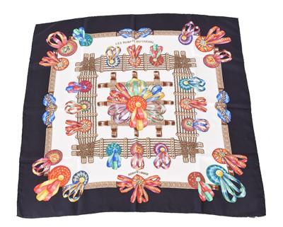"""Lot 17 - A Hermès """"Les Rubans du Cheval"""" silk scarf by Joachim Metz"""