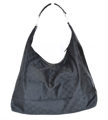 Lot 8 - A Gucci Extra Large Travel Hobo Bag
