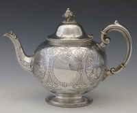 Lot 303-Silver tea pot.