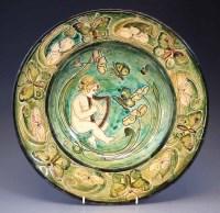 188 - Della Robbia charger,  decorated with a cherub
