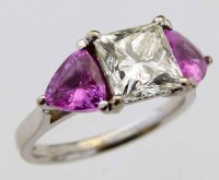 Lot 262-Pink sapphire and princess cut diamond three stone ring