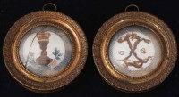 487 - A pair of 18th century circular urne mysterieuse miniatures (2).