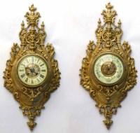 502 - Pair of brass barometers.