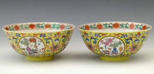 321 - Pair of yellow ground famille rose medallion bowls.