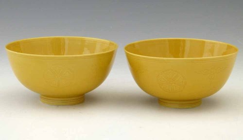 322 - Pair of incised yellow glazed bowls.