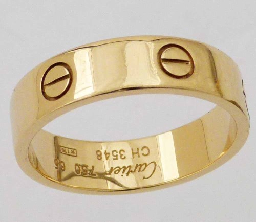 Lot 400-Cartier screw motif 750 gold ring, marked CH3548